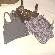 AEO, VS, & Aerie tank tops Green VS with gold sequins size small, Aerie gray with flower print size x small, and Hollister racer back with lace size x small Hollister Tops Tank Tops