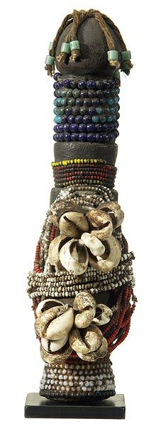 In Cameroon, when a young Fali man becomes betrothed, he makes a doll (ham pilu) from wood and decorates it with hair, beads, and other smal...