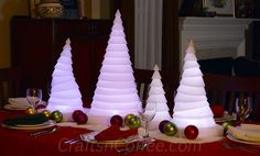 This Christmas centerpiece idea is made using STAK Trees and battery-powered lights. The lights shine through the STAK Tree, creating a warm glow. Add a few glass ornaments, and you have a magical Christmas centerpiece made in less than 30 minutes.