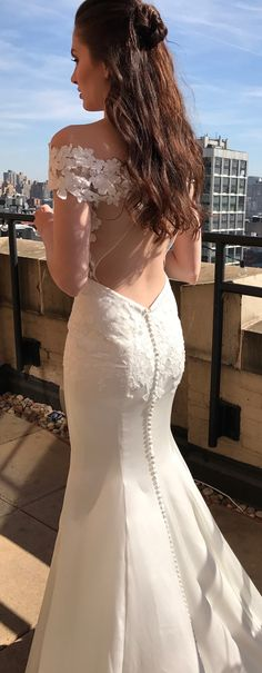 Emilia wedding dress by Kelly Faetanini // Silk stretch sating fit-to-flare gown with floral 3D appliques and open back