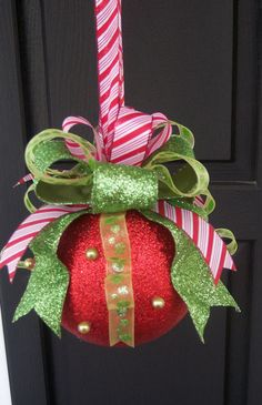 I've got loads of old plain red balls I can easily buy some nice ribbon and jazz them up to look like this