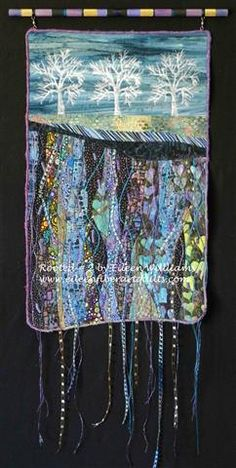 Rooted # 2 by Eileen Williams.  Landscape art quilt hanging from a painted dowel.