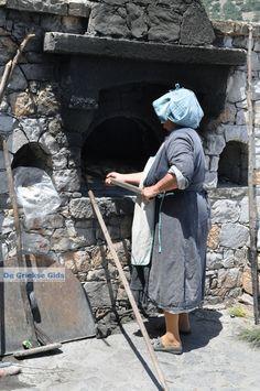 Woman of Diafani baking bread...