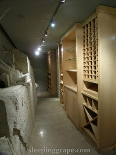 wine cellar with natural granite outcroppings.