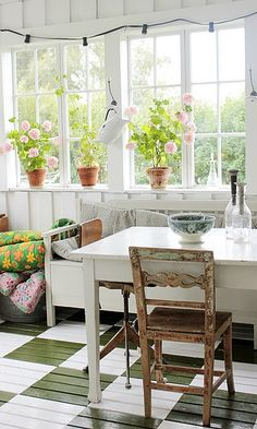 Porch room from Vintage House blog again a cool black and white painted floor