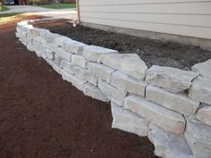 Large outcropping stone retaining wall.