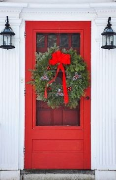 perfect winter red door for the farm house i would love to have one day...