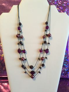 A personal favorite from my Etsy shop https://www.etsy.com/listing/289812457/fuchsia-tones-three-layer-necklace
