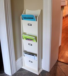 Love this magazine rack as an organizer for school papers and bills!