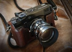 Fujifilm X-Pro1 with Voigtlander Nokton 50mm f/1.5 and a swoon brown leather case.