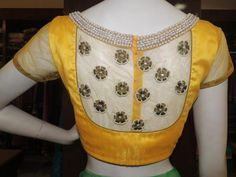 Photos of the latest saree blouse designs and some tips on how to wear them.