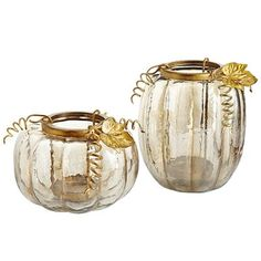 For anyone who loves fall, candles and/or pumpkins, our amber leaf pumpkins are a real treat. In the spirit of traditional jack-o-lanterns, these handcrafted glass pumpkins feature a lustrous amber finish and a hollow core. The golden, powder-coated iron holster is removable, making it easy to insert your favorite pillar. And that's no trick.