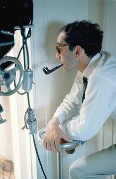Jean-Luc Godard on the set of Le Mépris (1963). (Via)