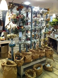 Love the crumpled rolled edges of the brown paper bags in this display!!! christmas store displays ideas - Bing Images