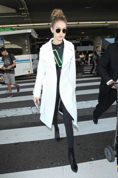 28 January Gigi Hadid kept it casual at LAX in a cream coat and Ray-Bans. - HarpersBAZAAR.co.uk