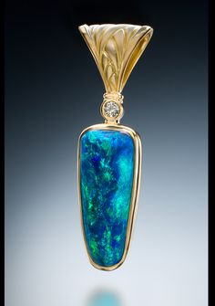 """Fabulous blue/green """"nobby"""" Black Opal from Lightning Ridge. Set in 18k gold with diamond by Conni Mainne"""