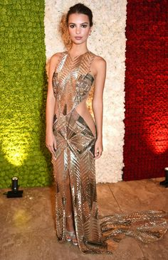 EMILY RATAJKOWSKI  dazzles in a gold metallic gown with cutout detailing at the Annabel's VIP preview in London.  http://people.com/style/last-nights-look-celebrity-red-carpet-photos-100316/emily-ratajkowski