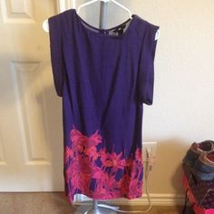H&M Purple dress with pink floral design Nice summer time dress with pink floral design at bottom and cute cut out in the back. H&M Dresses