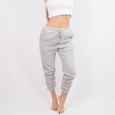 The Ball of Fuzz Joggers are our comfiest sweats yet. Soft + cozy knit in a baggy silhouette. Complete with a drawstring waistband and elasticized cuffed ankles. Get ready to live in them.  Available in Cream + Grey Poly Drawstring closure Cuffed ankles Model is wearing size S Imported