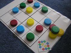 Sudoku con tapones de colores