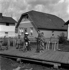 June 28, 1956 Boys playing on the boardwalk, Flin Flon, Manitoba, Canada.