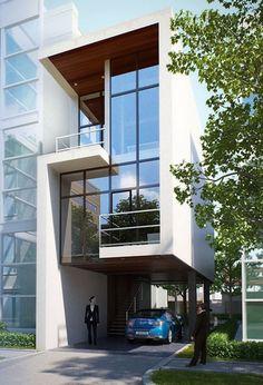 Fachada de moderna casa angosta de tres pisos