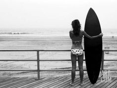 Model with Black Surfboard Standing on Boardwalk and Watching Wave on Beach Photographic Print by Theodore Beowulf Sheehan at Art.com