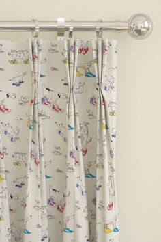 Pinch pleat curtains using Sanderson's Dogs in Clogs fabric.