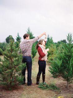 Romantic Christmas tree e-sesh! http://www.stylemepretty.com/2014/12/24/christmas-tree-farm-engagement-session-2/   Photography: Lauren Kinsey - http://laurenkinsey.com/