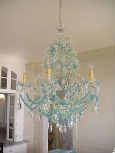 Love the color and girly bling of this chandelier but not too keen on the fake wax melting look. #chandelier #lighting #turquoise