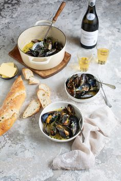 A classic recipe for fresh mussels steamed with white wine, garlic & cream #seafood #recipe #French