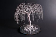 This is supposed to be a cake topper, but I'd use it just as decoration.  I love willow trees.  :)