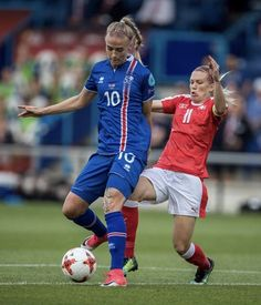 Lara Dickenmann #11 of Switzerland and Dagný Brynjarsdóttir #10 of Iceland battle for the ball during the UEFA Women's Euro 2017 Group C match between Iceland and Switzerland at Stadion De Vijverberg on July 22, 2017 in Doetinchem, Netherlands.