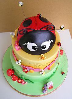ladybug cake ideas - I love this ladybug on top and the overall cake is overall adorable.