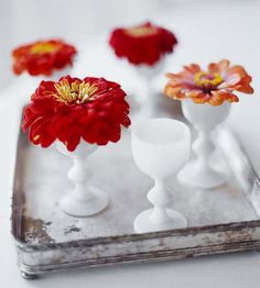 Pretty in Petite:Dainty milk-glass cordial glasses are the perfect size to showcase single blooms. Arrange a few glasses on a tray -- or a pretty serving dish -- to use them as a centerpiece. Egg Holder, Decoration Table, Centerpiece Ideas, Simple Centerpieces, Deco Floral, Flea Market Finds, Egg Cups, Better Homes And Gardens, Milk Glass