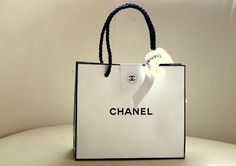 Chanel Gorgeous White With Black trim iconic shopping bag