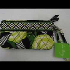 La neon rose Vera Bradley wristlet The gusseted interior on this accessory stays slim when needed, and expands to fit all the essentials. Inside, a zipper and four card pockets display your daily must-haves and a wristlet strap turns it all into a small handbag, sealed with a top-zip closure. Vera Bradley Accessories