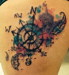 watercolor compass and feathers tattoo