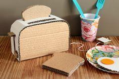 Mom's cardboard toy creations include a PAC-MAN console, Super 8 camera & a boom box Cardboard Kitchen, Cardboard Crafts Kids, Cardboard Playhouse, Cardboard Paper, Paper Toys, Cardboard Furniture, Diy For Kids, Crafts For Kids, Diy Karton