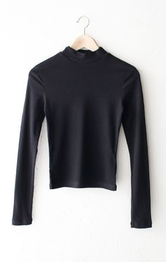 "- Description Details: Ribbed long sleeve mock neck top in black. Form-fitting, tend to run on the smaller side & are more fitted. Measurements (Size Guide): S: 30"" waist, 20.5"" length, 25"" sleeve len"