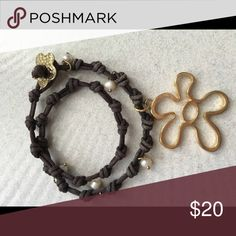 Leather charm bracelet or choker Really cool piece. Can were as choker necklace or bracelet. Real leather   Pearls and charms too   Bought at upscale boutique. Imported from South Anerica. Jewelry Bracelets