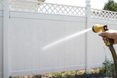 A white vinyl fence has all the attractiveness of a wood fence, but you don't have to worry about repairing weather-damaged wood or repainting the fence. White fences do show dirt sooner than other colors, but vinyl is easy to clean and is resistant to stains. Rinsing with the fence with water gets rid of surface dust and debris such as grass...