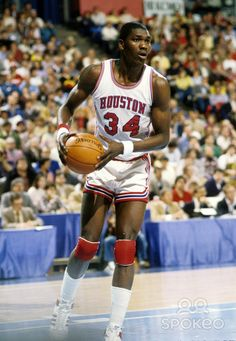 Hakeem Olajuwon, University of Houston center who led the Cougars to back to back NCAA title games in '83 & '84 (winning the MOP in '83). The 2 time all american has his jersey retired by the university.