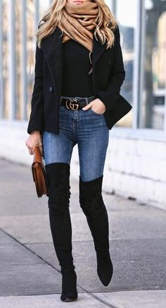 A simple beige scarf adds a pop of color to this sexy street style look. Combine your denims with basic black for the similar off-duty model style.