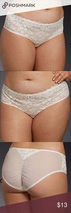 """NWT Torrid Lace Front Mesh Back Panties size 2 NWT Torrid Lace Front Mesh Back Panties size 2. This aww-dorable panty is a pretty sweet deal. The gorgeous floral ivory lace front is a delicate contrast to the very sexy sheer mesh back. The ruched center accentuates your booty, with a strap-detailed lace inset that puts the """"ooh"""" in ooh-la-la. torrid Intimates & Sleepwear Panties"""