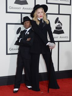 Music and fashion icon Madonna, along with her son David, chose Ralph Lauren tuxedos for the 56th Annual Grammy Awards.