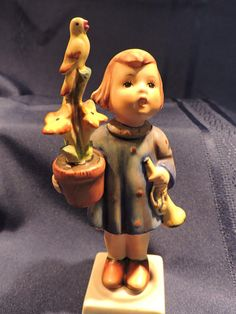 Congratulations Hummel Porcelain Collectible Young Woman with Bugle Potted Plant and Bird Figure W. Silver Dresser, Hummel Figurines, Counting Sheep, Home Decor Items, Potted Plants, Blue Bird, Young Women, Gifts For Him, Vintage Items