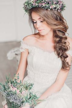 Romantic side braid with flower wedding hair
