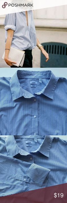 "Izod Classic Blue Pinstriped Button Down Shirt Izod Classic Blue Pinstriped Button Down Shirt  *Blue/White Stripes No iron/Wrinkle free *55% Cotton/ 45% polyester  *Size 2XL *Pit to pit : 27"" flat / Length : 27.5"" *In excellent pre-loved condition with minimal signs of wear  *No trade please *****Covershot is similar style for your outfit inspiration. Not actual product***** Izod Tops Button Down Shirts"