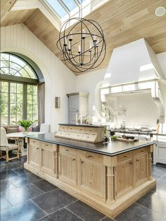 vaulted ceiling in kitchen, French country orb light pendant, shiplap, slate floors
